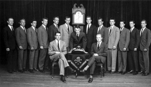 Skull and Bones members, with George H.W. Bush to the left of the clock. John Kerry and George Jr are also members.