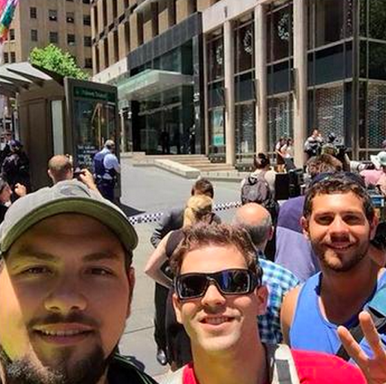 "Sydney Siege Selfies: Social Media Users Slammed As 'Disgusting & Disrespectful' By +Sara Nelson  As an ongoing hostage situation continues in Sydney, a number of people have been spotted taking beaming ""selfies"" at the scene. Crowds are gathering at the Lindt café on Martin Place, downtown Sydney, where there is believed to be a gunman who has forced hostages to hold a black flag with Arabic writing in the window of the cafe. As armed police assess the situation and relatives of those taken hostage pray for their safe release, some bystanders are choosing to mark the drama by taking photographs of themselves at the scene.  (courtesy of the Huffington Post https://plus.google.com/+HuffPostUK/posts/MHvfEp767of?pid=6093007567752431666&oid=100175498851595503678)"